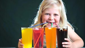 kid-drinking-four-sodas